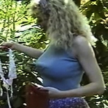 Gathering stockings. A luscious blonde delights in her discovery of silky stockings in the trees