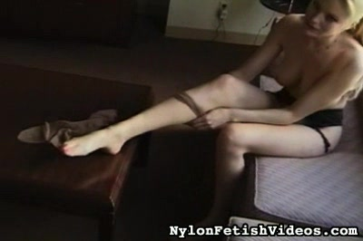 Nylons at the top A exciting blonde clothes her legs in the finest nylons as she starts her day.