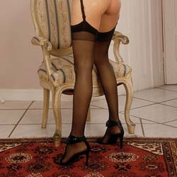 Black nylons  trim legs and a spankable fuckable ass. Trim legs, and a spankable, fuckable butt