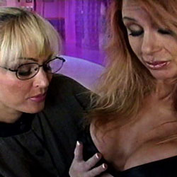 Two milfs. Lavender bra and what is in them.